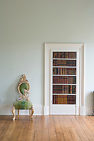 Bookshelf panelled door with chair