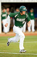 Justin Seager (10) of the Charlotte 49ers hustles down the first base line against the High Point Panthers at Willard Stadium on February 20, 2013 in High Point, North Carolina.  The 49ers defeated the Panthers 12-3.  (Brian Westerholt/Four Seam Images)