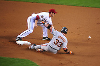 Apr. 21, 2008; Phoenix, AZ, USA; Arizona Diamondbacks shortstop Stephen Drew attempts to tag out San Francisco Giants base runner (33) Aaron Rowand at Chase Field. Mandatory Credit: Mark J. Rebilas-