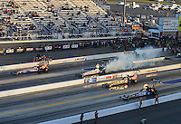 Apr. 13, 2012; Concord, NC, USA: NHRA top fuel dragster drivers (right to left) Antron Brown , Terry McMillen , Doug Herbert and Dom Lagana race four-wide during qualifying for the Four Wide Nationals at zMax Dragway. Mandatory Credit: Mark J. Rebilas-