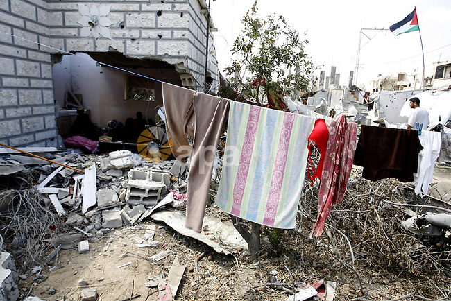 "A Palestinian man walks past a destroyed house in Khan Yunis in the southern Gaza Strip on September 11, 2014. Israel's deputy foreign minister,Tzahi Hanegbi , warned that Hamas was likely to resume ""violence"" if it feels it has made no political gains from upcoming talks in Cairo. Photo by Abed Rahim Khatib"