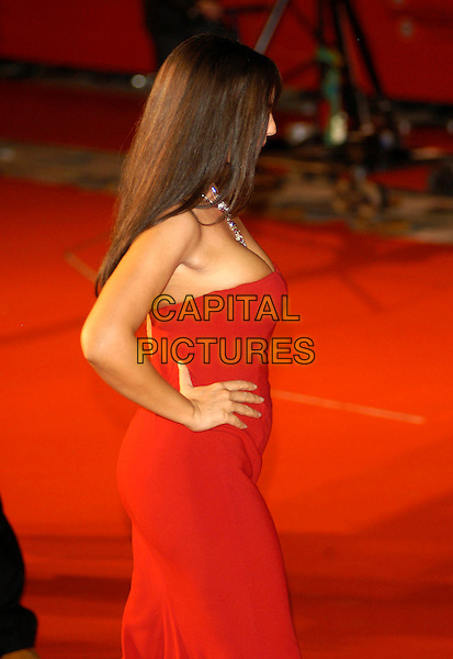 """MONICA BELLUCCI.Attends the Red Carpet Premiere of """"N (Io e Napoleone)"""".during the Rome film Festival,.Rome, Italy, October 14th 2006..half length red dress hand on hip rear bum.Ref: CAV.www.capitalpictures.com.sales@capitalpictures.com.©Luca Cavallari/Capital Pictures."""