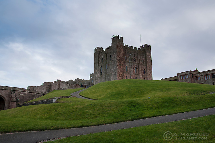 The Bamburgh Castle is one of the largest inhabited castles in the UK. Located in northeast England, right by the beach on the shores of Northumberland. With a recorded history going back to the year 547, Bamburgh Castle played a central role in many of the historic periods of this region..In 1894, Bamburgh Castle was bought by Lord William Armstrong for £60,000. To this day the castle is inhabited by the Armstrong family.