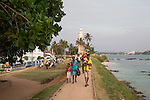 People walking on fort ramparts in historic town of Galle, Sri Lanka, Asia