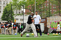 Juan Pablo Angel of the New York Red Bulls instructs students on taking a shot during a soccer clinic prior to a press conference announcing former President Bill Clinton (not pictured) as the honorary chairman of the USA Bid Committee to host the FIFIA World Cup in 2018 or 2022 at the FC Harlem Field in Harlem, NY, on May 17, 2010.