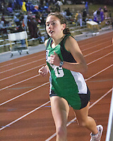 Ste. Genevieve junior Shelby Werner runs to a third place finish and personal best time of 11:32 for the 3200 meter race at the Festus Tiger Town Track and Field Invitational, Tuesday, April 2, 2013, Festus, Mo.