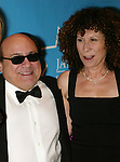 "Danny Devito and Rhea Perlman.Attending the Star-Studded Benefit, ""Some Enchanted Evening"",  for EIF's National Colorectal Cancer Research Alliane and the Jay Monahan Center for Gastrointestinal Health on Cunard's Queen Mary 2 in New York City..April 24, 2004."