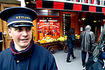 PARIS - FRANCE - 15 APRIL 2004--A doorman ready to give a hand in front of the fine food shop Hediard at Place de la Madeleine.-- PHOTO: ERIK LUNTANG / EUP-IMAGES