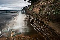 A small waterfall at Lake Superior at Pictured Rocks National Lakeshore near Munising Michigan on Michigan's Upper Peninsula.