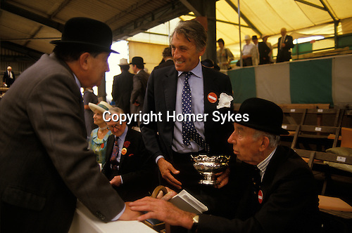 David Somerset Duke of Beaufort holding silver Rose Bowl at the Peterborough Hound show Cambridgeshire.
