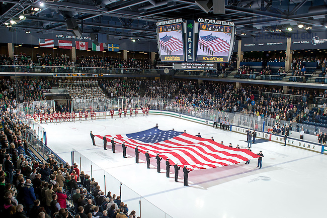 Jan. 29, 2016; ROTC cadets and midshipmen hold an oversize U.S. Flag during the national anthem at Compton Family Ice Arena. (Photo by Matt Cashore/University of Notre Dame)