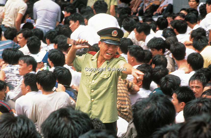 A soldier screams at a crowd during a riot in Shenzhen, China.