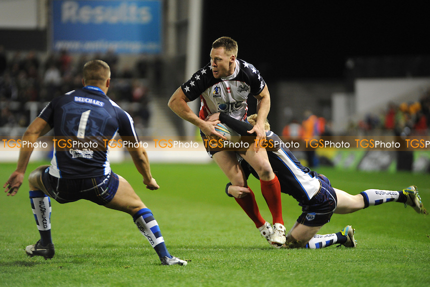 Scotland's Peter Wallace tackles USA's Matthew Shipway  - Scotland vs USA - Rugby League World Cup 2013 Group C/D at Salford City Stadium, Eccles, Greater Manchester - 07/11/13 - MANDATORY CREDIT: Greig Bertram/TGSPHOTO - Self billing applies where appropriate - 0845 094 6026 - contact@tgsphoto.co.uk - NO UNPAID USE