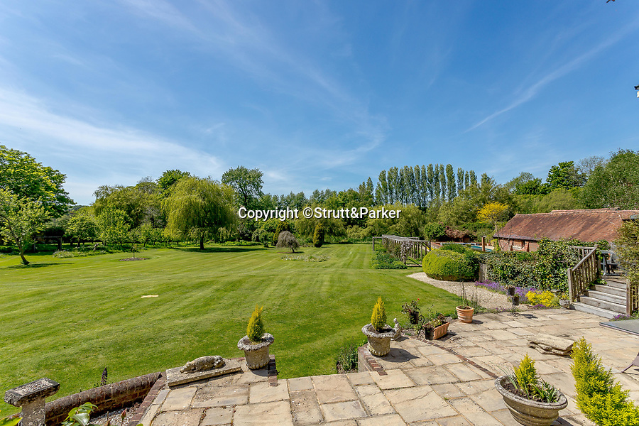 BNPS.co.uk (01202 558833)<br /> Pic: Strutt&Parker/BNPS<br /> <br /> A breathtaking country home that comes with its own fishing rights in a well-stocked river has emerged for sale for £2.5m.<br /> <br /> Hockley House in the Hampshire village of Twyford sits on the banks of the river Itchen which runs between Winchester and Southampton.<br /> <br /> The stylish nine bed home has direct access to the 28 mile waterway and has a license allowing residents to fish in the grounds.<br /> <br /> The river has a bustling population of brown trout and is also home to a number of other species including water voles and otters.