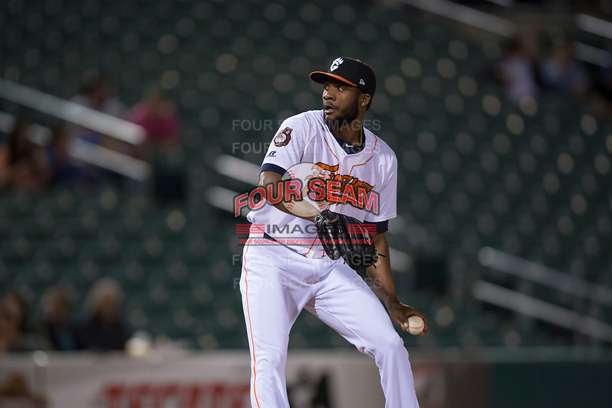 Fresno Grizzlies relief pitcher Reymin Guduan (19) delivers a pitch to the plate during a Pacific Coast League game against the Salt Lake Bees at Chukchansi Park on May 14, 2018 in Fresno, California. Fresno defeated Salt Lake 4-3. (Zachary Lucy/Four Seam Images)