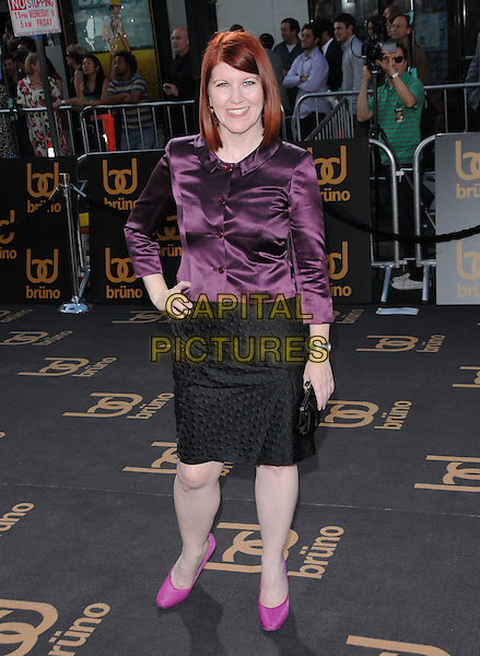 """KATE FLANNERY.The Universal Pictures' L.A. Premiere of """"Bruno"""" held at the Grauman's Chinese Theatre in Hollywood, California, USA. .June 25th, 2009.full length hand on hip black skirt purple silk satin blouse shoes pink clutch bag .CAP/DVS.©Debbie VanStory/Capital Pictures."""