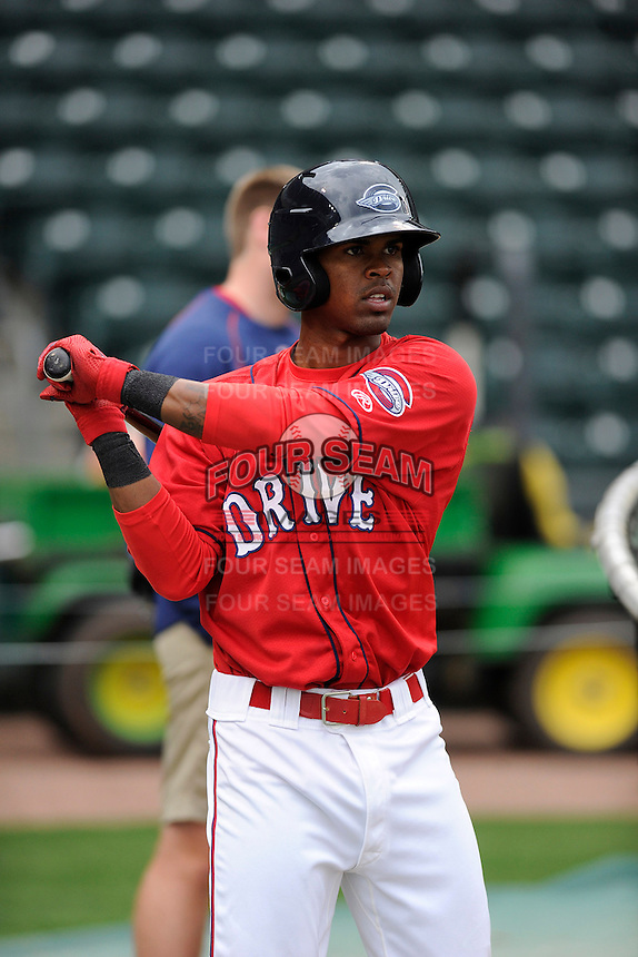 Outfielder Joseph Monge (15) of the Greenville Drive during a Media Day first workout of the season on Tuesday, April 7, 2015, at Fluor Field at the West End in Greenville, South Carolina. (Tom Priddy/Four Seam Images)
