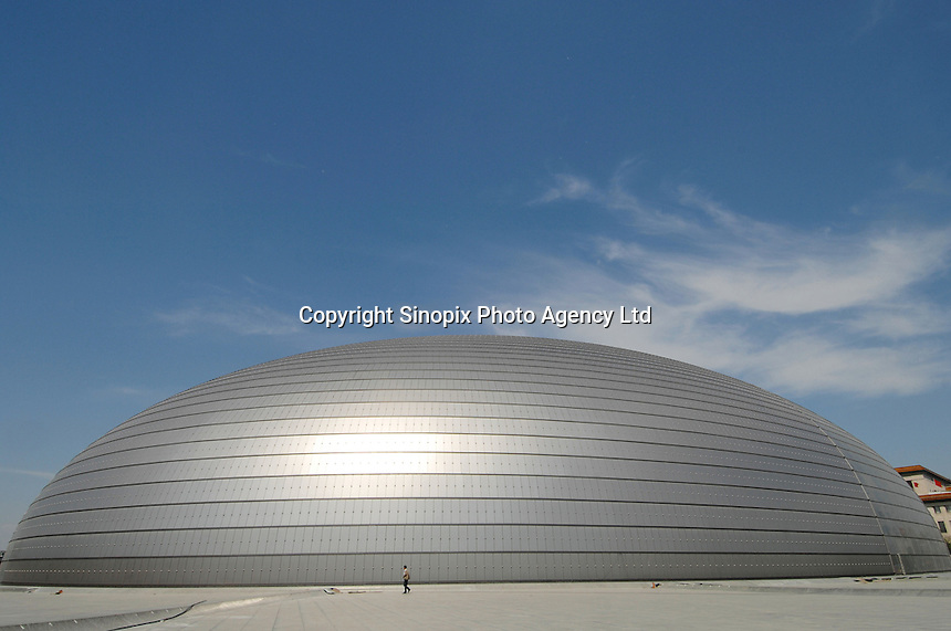 "Some of the final ground-work and land-scaping is carried out at the new Beijing National Theatre, locally known as ""the egg"".  The  building will open before the 2008 Beijing Olympics..02 May 2007"