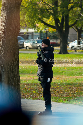 As seen through the window of the pool bus, a Secret Service agent scans the area around the Regents Park apartment complex as President-Elect Obama prepares to leave after working out on Wednesday.