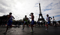 09 JUL 2011 - PARIS, FRA - Competitors race past the Eiffel Tower during the men's French Grand Prix series race .(PHOTO (C) NIGEL FARROW)