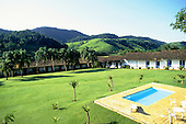 Rio de Janeiro State, Brazil. Fazenda Ponte Alta hotel; swimming pool and old slave quarters, used as guest accommodation