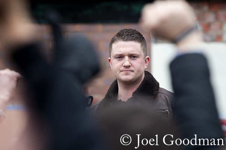 © Joel Goodman - 07973 332324 . 25/02/2012 . Hyde , UK . EDL leader TOMMY ROBINSON delivers a speech at the rally . The EDL demonstrate following an assault on Daniel Stringer-Prince, whose family say they do not want the demonstration to take place in the town in their son's name. The EDL say Daniel was assaulted by a gang of Asian men . At the same time , the BNP hold a rally in the town . Photo credit : Joel Goodman