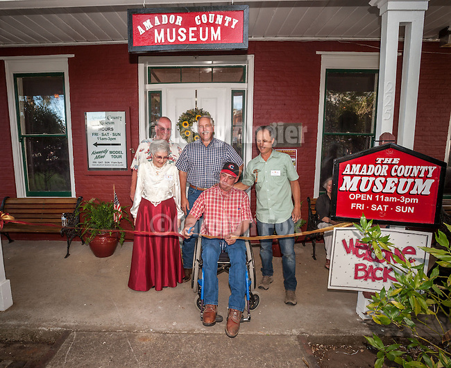 Ribbon cutting at the grand reopening of the Amador County Museum, The Brown House, Jackson, Calif.<br /> <br /> Tom Oneto cuts the ribbon as museum curator Georgia Fox, Jackson Mayor Pat Crew, County Supervisor John Plasse and Amador Historical Society President Phil Giurlani look on.
