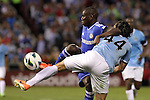 23 May 2013:  Demba Ba (left)(FRA) of Chelsea battles for a loose ball against Karim Rekik (44)(NED) of Manchester City.  Chelsea F.C. was defeated by Manchester City 3-4 at Busch Stadium in Saint Louis, Missouri, in a friendly exhibition soccer match.