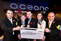 UNP 26163 / Luminar Leisure Limited??Oceana Southampton, giant cheque presentation.??L-R: Russ Girdlerstow ( door supervisor), Charlotte Hayes (crew), Darren Harfield (operations manager), Faye Willimott (senior crew leader), Mike Broomfield (door supervisor).??Three members of the Oceana club (centre) show their medals for participating in the Great South Run.  Two other members of the team who helped them raise the cash hold the cheque for the amount they raised for the Echo Trust.???Date Taken: 10/11/10??Location:?Oceana Southampton nightclub ?Leisureworld?West Quay Road?Southampton?SO15 1RE??Contact:?Darren 07595 543334??Commissioned by:  UNP?Mandy Taylor?UNP Ltd.24 Victoria Road,.Saltaire,.BD18 3JR.England, UK.P 01274 412222.F 01274 590999.iSDN 01274 420446.email: mandy@unp.co.uk