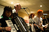 Editorial coverage of a performance by Punk/Folk band 'The Roughneck Riot, Bury, UK.