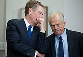 Director of the White House National Trade Council Peter Navarro (R) and Director of the Office of <br /> US Trade Representative Robert Lighthizer (L) speak with one another before the signing of a presidential proclamation on steel and aluminum tariffs by US President Donald J. Trump, in the Roosevelt Room of the White House in Washington, DC, USA, 08 March 2018. President Trump is imposing tariffs on steel and aluminum imports. A decision to impose the tariffs on Canada or Mexico will not be decided until negotiations on the North American Free Trade Agreement (NAFTA).<br /> Credit: Michael Reynolds / Pool via CNP