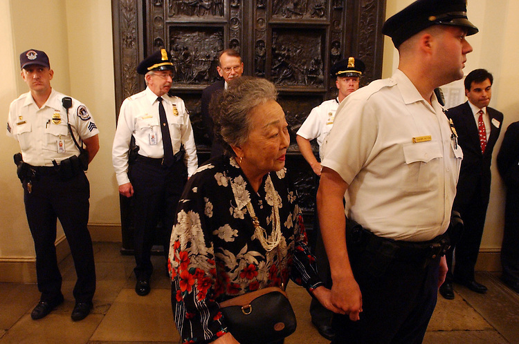 memorial1/072403 - Kuei-Chih Chang, Mother of widow Wen-Ling Chestnut holds the hand of Officer Shawn Huycke during  a memorial service in honor of Officer J.J. Chestnut and Detective John Gibson who died protecting the Capitol July 24, 1998.