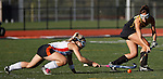 Central York's senior Kayla Smith, left, struggles to keep the ball from Red Lion's senior Megan Greenplate during the first half. The Lions defeated the Panthers, 3-2, to close out their field hockey season. (For the Daily Record/Sunday News -- Shane Keller)