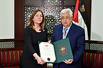 "Palestinian President Mahmoud Abbas gives the medal of ""Grand star of the order of Jerusalem"" for Hala al-Shareef, the wife of late Othman Abu Gharbia, at his headquarters in the West bank city of Ramallah on March 4, 2018. Photo by Thaer Ganaim"