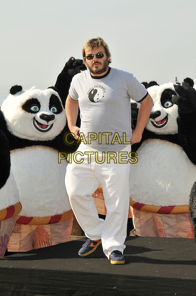 "JACK BLACK.Photocall for ""Kung Fu Panda"" on The Carlton Hotel pier at the 61st Cannes International  Film Festival, Cannes, France..14th May 2008 .full length white trousers grey gray top sunglasses shades beard facial hair .CAP/PL.© Phil Loftus/Capital Pictures"