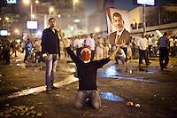 A pro Morsi protester is holding a poster of ousted President Mohammed Morsi during clashes in downtown Cairo, Egypt, Monday, July 15, 2013. <br /> <br /> Une manifestation pro Morsi tient un poster du pr&eacute;sident d&eacute;chu Mohammed Morsi lors d'affrontements dans le centre du Caire, en Egypte, le lundi 15 Juillet 2013.