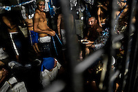 "Members of the Mara Salvatrucha gang (MS-13) eat lunch in an overcrowded cell at the detention center in San Salvador, El Salvador, 20 February 2014. Although the country's two major gangs reached a truce in 2012, the police holding cells currently house more than 3000 inmates, five times more than the official built capacity. Partly because the ordinary Mara gang members did not break with their criminal activities (extortion, street-level distribution of drugs, etc.), partly because Salvadorean police still applies controversial anti-gang law which allows to detain almost anyone for ""suspicion of gang membership"". Accused young men are held in police detention centers where up to 25 inmates may share a cell of five-by-five metres. Here, in the dark overcrowded cages, under harsh and life-threatening conditions, suspected gang members wait long months, sometimes years, for trial or for to be transported to a regular prison."