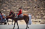 An Egyptian boy rides horse in front of the Giza pyramids, on the third day of Eid al-Fitr holiday which marks the end of the Muslim holy month of Ramadan, in Cairo June 27, 2017. Photo by Amr Sayed
