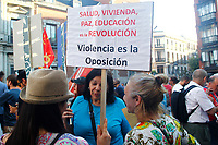 "Demonstrators supports President Maduro holding a poster entitle ""Health, home, peace, education, Revolution. opositora are violence""."
