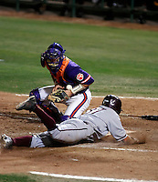 Drew Maggi of the Arizona State Sun Devils slides safely home, evading the tag by Clemson Tigers catcher John Nester in the NCAA Super Regional Tournament won by ASU at Packard Stadium, Tempe, AZ - 06/07/2009. .Photo by:  Bill Mitchell/Four Seam Images