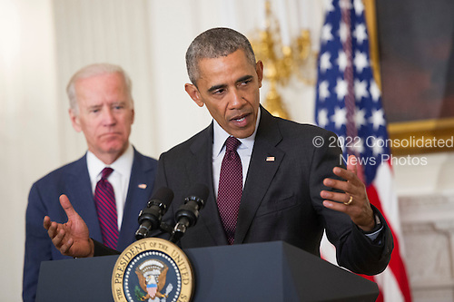 United States President Barack Obama, joined by Vice President Joe Biden, delivers remarks at the Easter Prayer Breakfast at the White House in Washington, D.C. on March 30, 2016.<br /> Credit: Kevin Dietsch / Pool via CNP