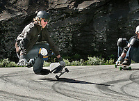 Missing his turn, a rider wipes out. The first ever Norwegian Longboarding Championship was held during the Extreme Sport Week, an annual event that draws adrenalin junkies to the small Norwegian mountain town of Voss. © Fredrik Naumann
