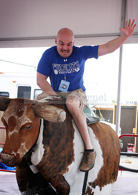 Eric Smith, a Kentucky native, rides a mechanical bull before the Final Four game at Reliant Stadium in Houston, TX for the Final Four on Saturday, April 2, 2011.  Photo by Britney McIntosh | Staff