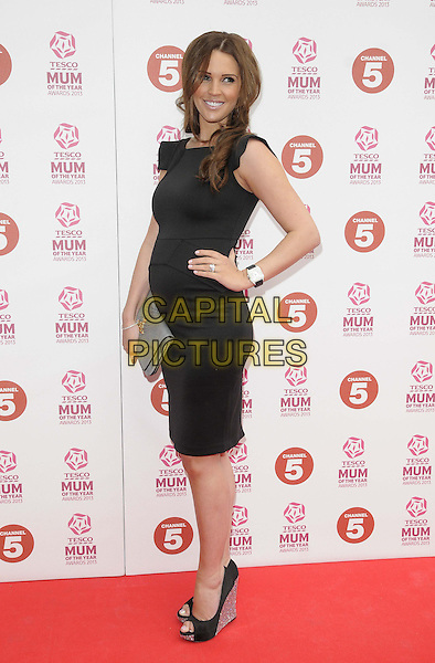 Danielle O'Hara ( nee Lloyd ).attended the Tesco Mum Of The Year Awards 2013, Savoy Hotel, The Strand, London, England..March 3rd, 2013.full length   dress black hand on hip grey gray clutch bag pregnant side .CAP/CAN.©Can Nguyen/Capital Pictures.