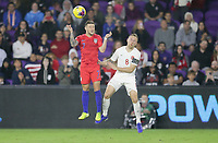 ORLANDO, FL - NOVEMBER 15: Paul Arriola #7 of the United States and Scott Arfield #8 of Canada battle for a head ball during a game between Canada and USMNT at Exploria Stadium on November 15, 2019 in Orlando, Florida.