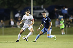 CARY, NC - OCTOBER 06: Wake Forest's Jon Bakero (ESP) (7) and UNC's Alex Comsia (CAN) (4). The University of North Carolina Tar Heels hosted the Wake Forest University Demon Deacons on October 6, 2017 at Koka Booth Field at WakeMed Soccer Park in Cary, NC in a Division I college soccer game.