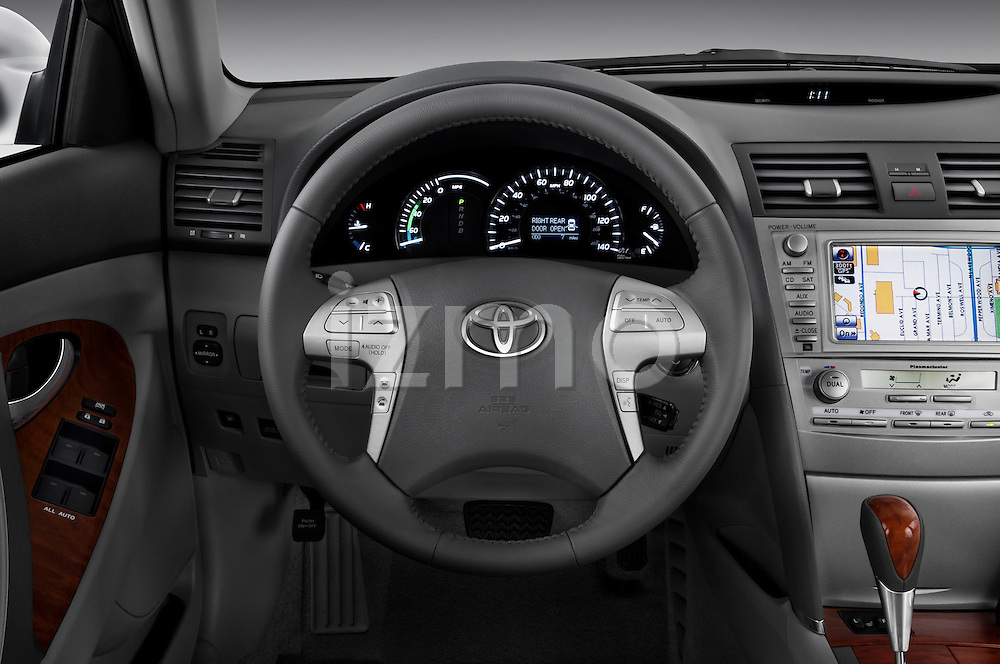 Steering wheel view of a 2010 Toyota Camry Hybrid