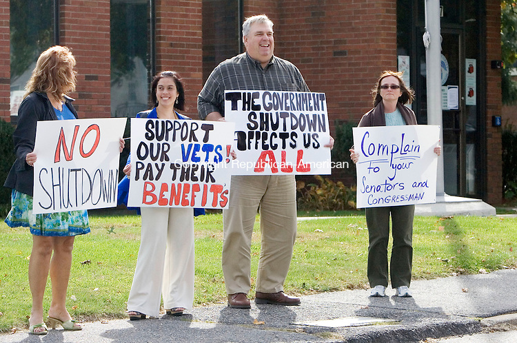TORRINGTON CT. 09 October 2013-100913SV08-Ted Woznicki, center, and three other employees that did not want to be identified hold up a sign outside the Social Security Administration office in Torrington Wednesday. Employees at the Social Security Administration office in Torrington were protesting the federal government shutdown during their lunch break. The office is only doing limited services during the shutdown.<br /> Steven Valenti Republican-American