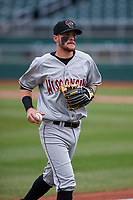Wisconsin Timber Rattlers second baseman Brice Turang (2) jogs off the field between innings of a Midwest League game against the Lansing Lugnuts at Cooley Law School Stadium on May 1, 2019 in Lansing, Michigan. Wisconsin defeated Lansing 8-3 after the game was suspended from the previous night. (Zachary Lucy/Four Seam Images)