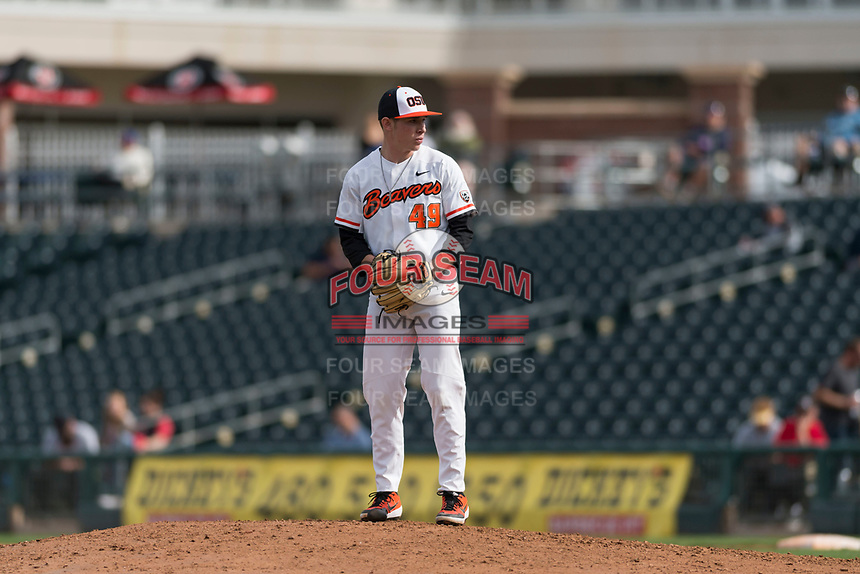 Oregon State Beavers relief pitcher Dylan Pearce (49) prepares to deliver a pitch during a game against the New Mexico Lobos on February 15, 2019 at Surprise Stadium in Surprise, Arizona. Oregon State defeated New Mexico 6-5. (Zachary Lucy/Four Seam Images)